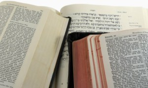 English (KJV), German, and Hebrew Bibles open to Isaiah 55, with clipping path