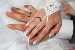 hands-with-wedding-rings